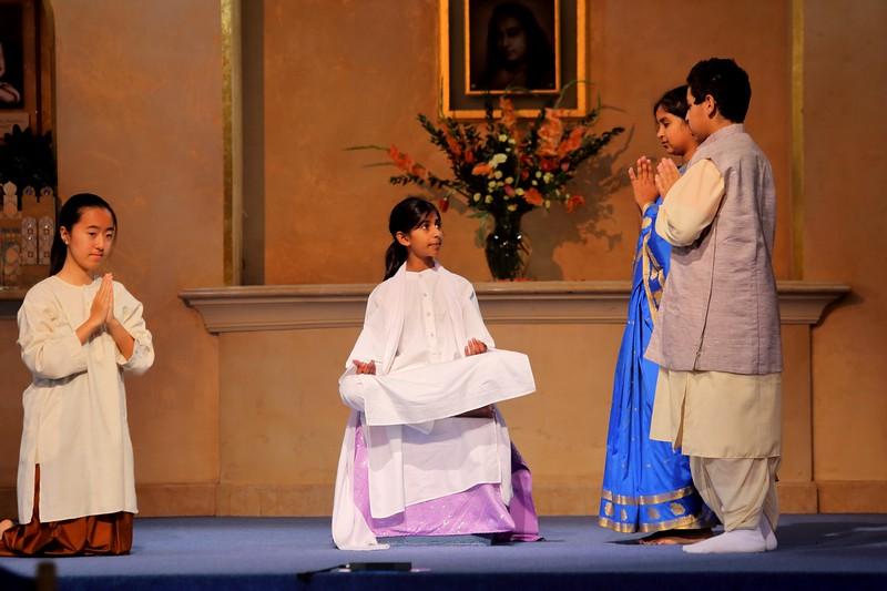 If I remember rightly, this is Lahiri Mahasaya receiving Yogananda's parents. ?