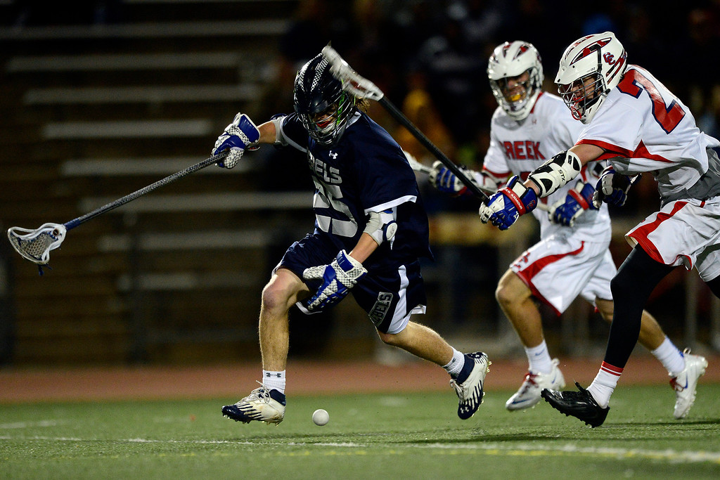 . Columbine\'s Blake Ortiz tries to wrangle a loose ball during Cherry Creek\'s 7-6 win.  (Photo by AAron Ontiveroz/The Denver Post)