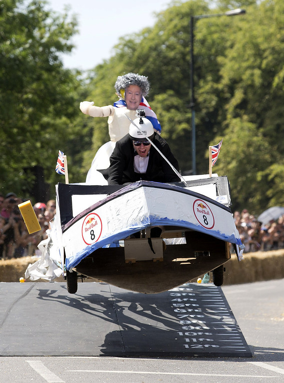 . A team goes over an obstacle as they compete in the Red Bull Soapbox race in London on July 14, 2013. The Red Bull Soapbox race is an annual event where amateur drivers race with their homemade soapbox vehicles down a 420m hill through obstacles  JUSTIN TALLIS/AFP/Getty Images