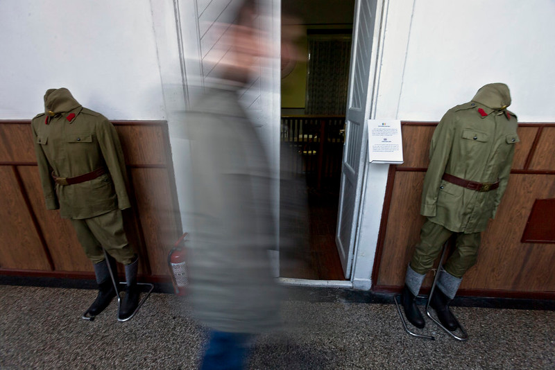 . A picture taken on Dec. 15, 2014 shows a man walking by the room at the military garrison, turned museum, in Targoviste, Romania, where Romanian communist dictator Nicolae Ceausescu and his wife Elena spent their final days before being executed on Dec. 25, 1989.  (AP Photo/Vadim Ghirda)