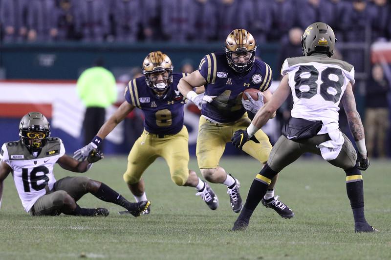 Navy linebacker #41 Tyler Pistorio intercepts Army quarterback #8 Kelvin Hopkins Jr. to seal the game.