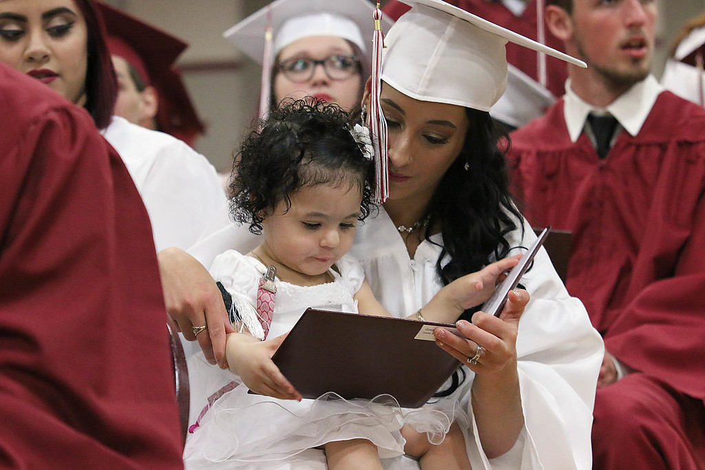 . Scenes from the Fitchburg Goodrich Academy graduation at Fitchburg High School on Thursday June 1, 2017. Graduate Ivett Gonsalez shows her diploma to her daughter Mya Estrella, 1, during the ceremony. SENTINEL & ENTERPRISE/JOHN LOVE
