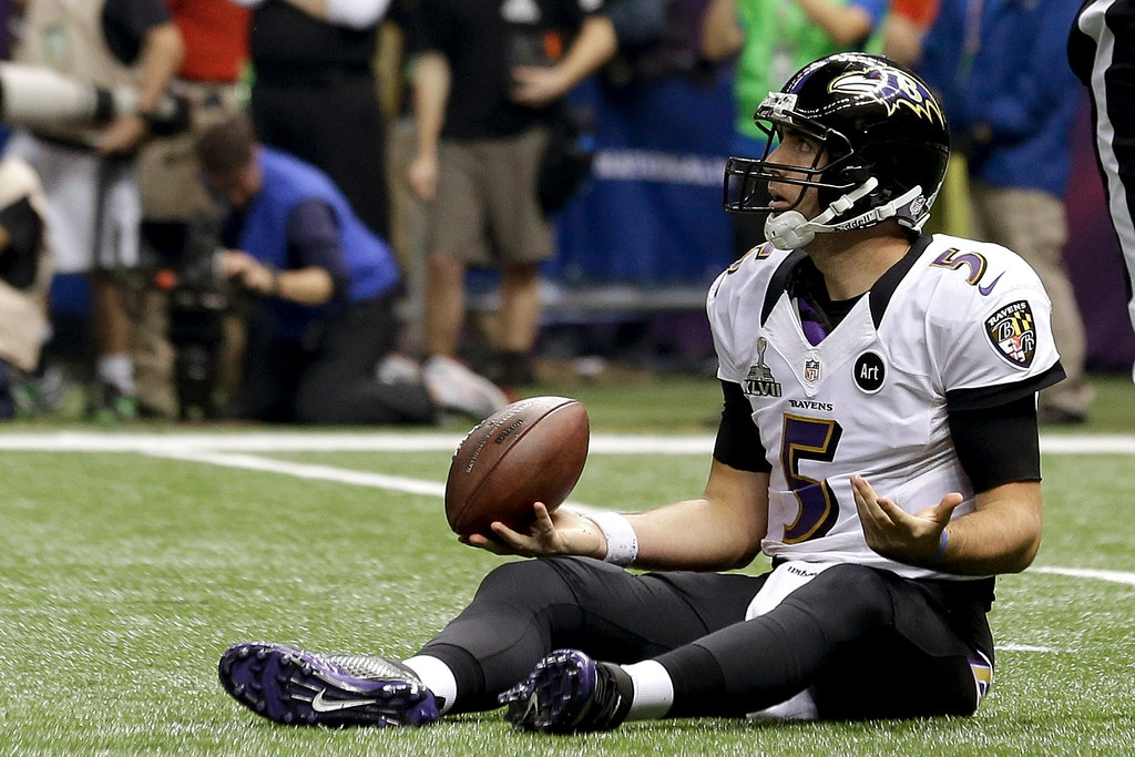 . Baltimore Ravens quarterback Joe Flacco (5)  sits on the field after being sacked by San Francisco 49ers\' Ahmad Brooks during the second half of the NFL Super Bowl XLVII football game, Sunday, Feb. 3, 2013, in New Orleans. (AP Photo/Julio Cortez)