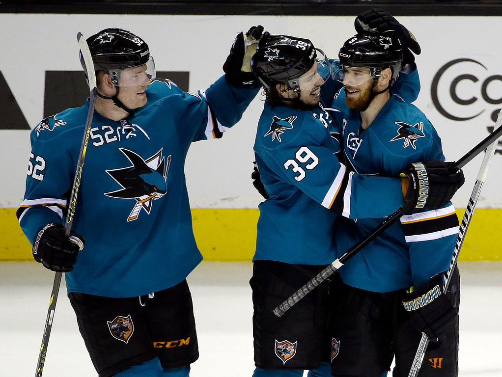 . San Jose Sharks\' Martin Havlat, right, of the Czech Republic, celebrates his third goal of the game against the Colorado Avalanche with teammates Logan Couture (39) and Matt Irwin (52) during the third period of an NHL hockey game on Friday, April 11, 2014, in San Jose, Calif. San Jose won 5-1.(AP Photo/Marcio Jose Sanchez)