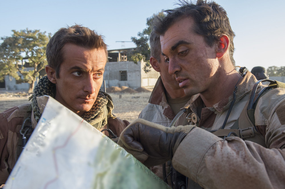 ". In this picture released by the French Army Communication Audiovisual office (ECPAD) French soldiers check a map at an undisclosed location, north of the Malian capital, Bamako, Wednesday, Jan. 16, 2013. French troops pressed northward in Mali toward territory occupied by radical Islamists on Wednesday, military officials said, announcing the start of a land assault that will put soldiers in direct combat ""within hours.\"" (AP Photo/Arnaud Roine, ECPAD)"