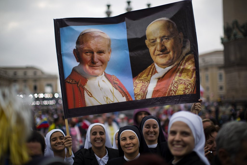 """. <p><b> Millions of pilgrims flocked to the Vatican on Sunday to witness the historic moment when Pope Francis officially declared Pope John Paul II and Pope John XXIII to be � </b> <p> A. Saints <p> B. Angels <p> C. His top two picks in the Papal Fantasy Draft <p><b><a href=\'http://www.twincities.com/breakingnews/ci_25647823/2-living-popes-honor-2-dead-ones-ceremony\' target=\""""_blank\""""> LINK </a></b> <p>   (AP Photo/Emilio Morenatti)"""