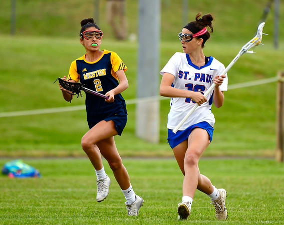 5/29/2019 Mike Orazzi | Staff St. Paul's Greta Panke (16) and Weston's Sonia Mody (2) during Wednesday's Class S First Round lacrosse match in Bristol.
