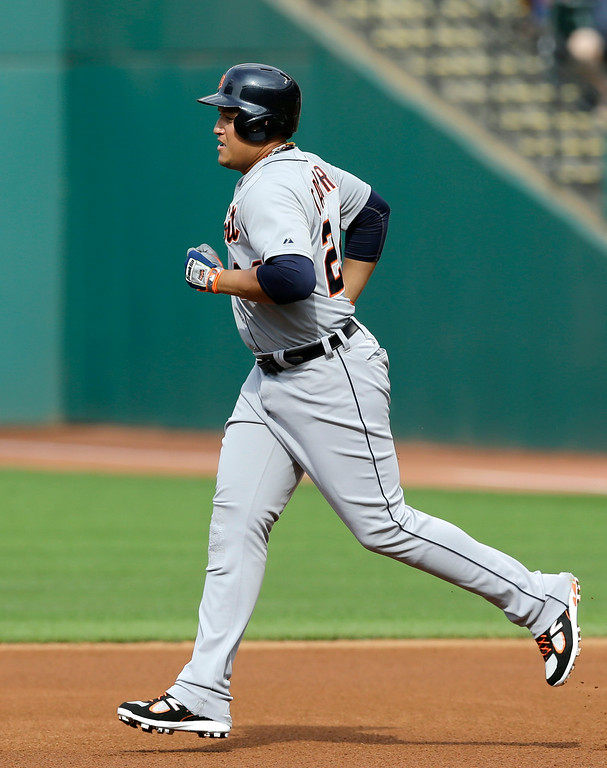 . Detroit Tigers\' Miguel Cabrera runs the bases after hitting a two-run home run off Cleveland Indians starting pitcher Corey Kluber in the first inning of a baseball game, Monday, Sept. 1, 2014, in Cleveland. Ian Kinsler scored on the play. (AP Photo/Tony Dejak)