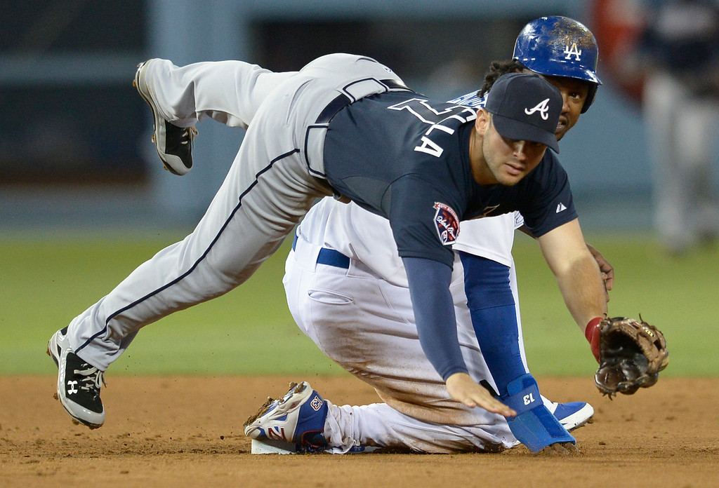 . Hanley Ramirez slides into 2nd base tripping up Tommy La Stella to break up a double play in the 4th inning. The Dodgers played host to the Atlanta Braves in a game played at Dodger Stadium in Los Angeles, CA. 7/30/2014(Photo by John McCoy Daily News)