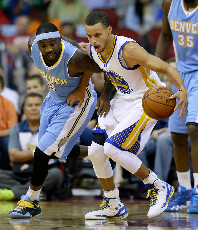 . Golden State Warriors guard Stephen Curry, right, grabs a loose ball in front of Denver Nuggets guard Ty Lawson during the first half of a preseason NBA basketball game, Thursday, Oct. 16, 2014, in Des Moines, Iowa. (AP Photo/Charlie Neibergall)