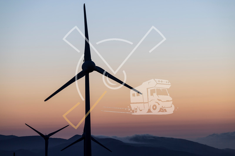 A wind far with wind turbines at Planalto dos Graminhais in a poetic sunset setting, serving as a perfect image for green sustainable renewable engery.