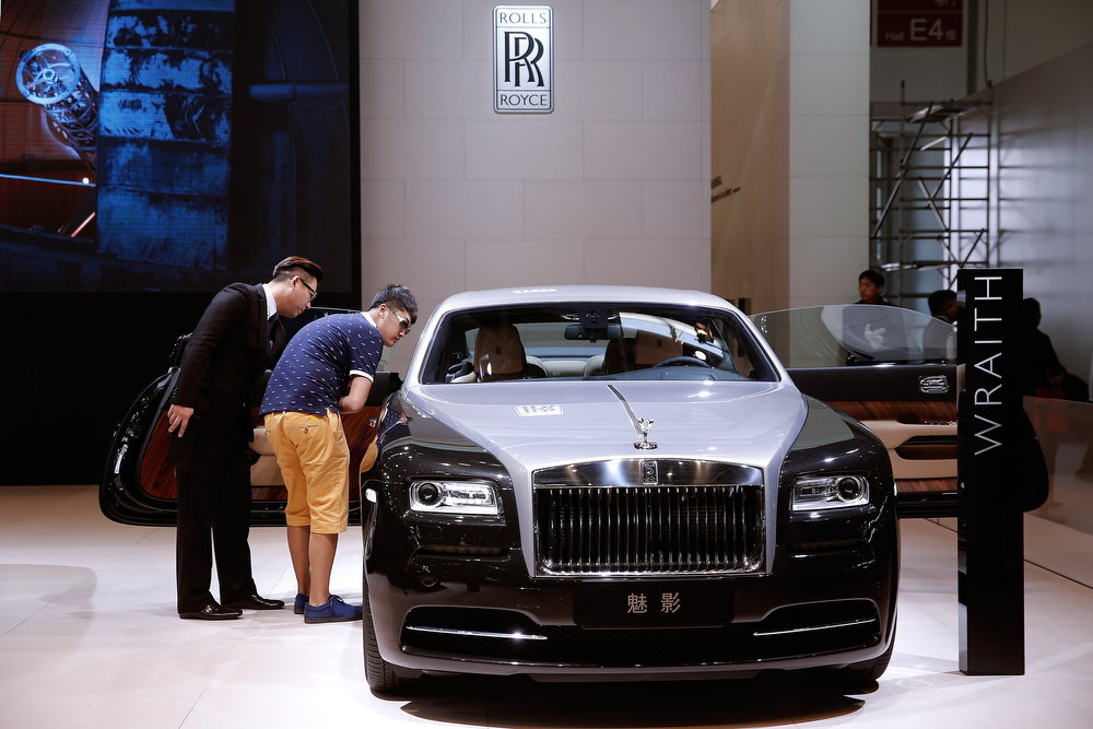 . A person stands beside Rolls-Royce Phantom car during the 2014 Beijing International Automotive Exhibition at China International Exhibition Center on April 22, 2014 in Beijing, China. More than 2,000 automotive enterprises from 14 countries and regions participated in the 2014 Beijing International Automotive Exhibition from April 20 to April 29.  (Photo by Lintao Zhang/Getty Images)