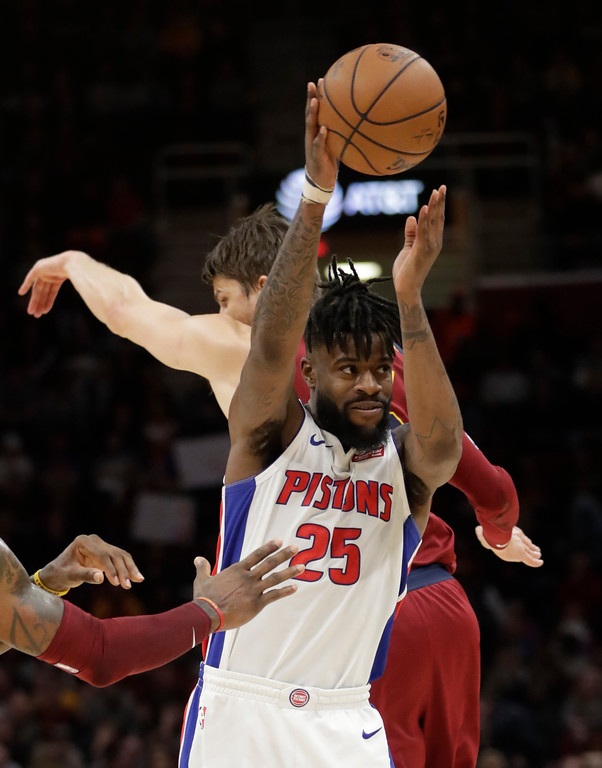 . Detroit Pistons\' Reggie Bullock (25) passes against the Cleveland Cavaliers in the second half of an NBA basketball game, Sunday, Jan. 28, 2018, in Cleveland. (AP Photo/Tony Dejak)