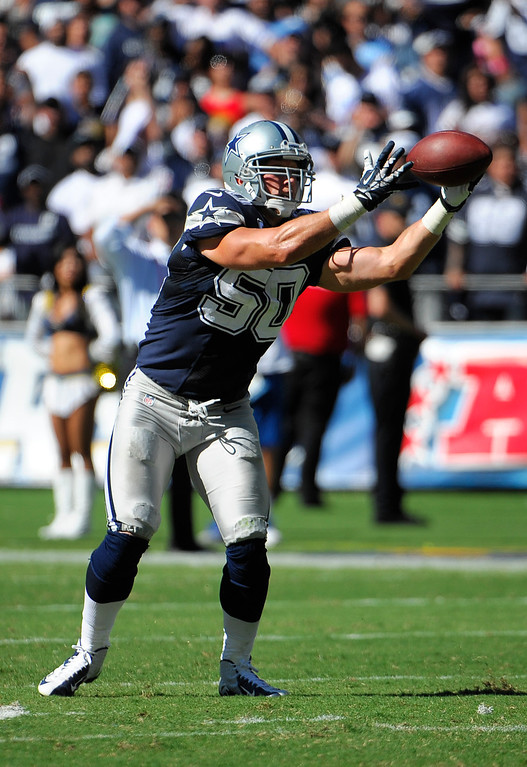 . Dallas Cowboys middle linebacker Sean Lee intercepts a pass for a touchdown against the San Diego Chargers during the first half of an NFL football game Sunday, Sept. 29, 2013, in San Diego. (AP Photo/Denis Poroy)