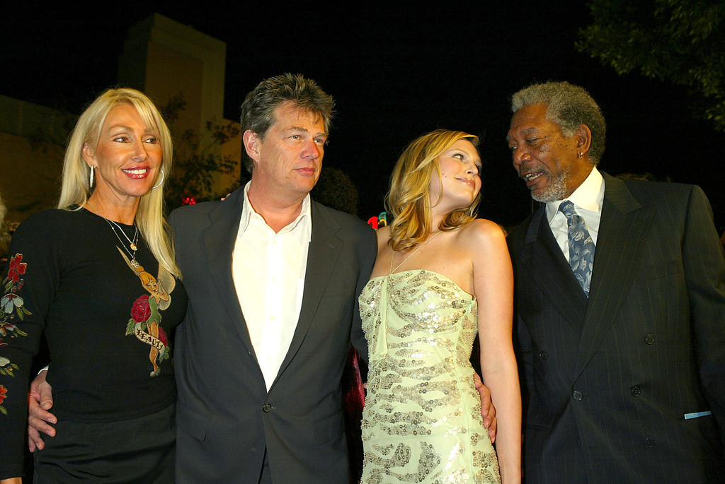 ". WESTWOOD, CA  - JANUARY 29:  (L to R) Songwriters Linda and David Foster, his daughter actress Sara Foster and actor Morgan Freeman arrive at the Los Angeles premiere of Warner Bros. ""The Big Bounce\"" at the Mann\'s Village on January 29, 2004 in Westwood, California. (Photo by Kevin Winter/Getty Images)."