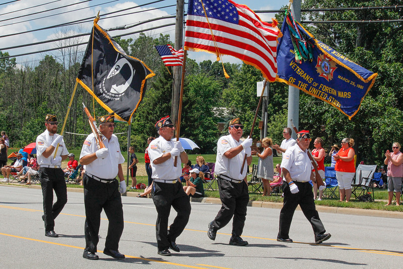 ALEC SMITH / GAZETTE Flags and a military color guard lead a parade on Center Road (state Route 303) on Sunday in Brunswick as part of the city's 2017 Summer Celebration. Shown from left in front are Josh Hakes (in rear), Bill Bland, Commander Norm Cerny, Bob Merrill and Tom Chester. Leo Chaney was also part of the group from  VFW Post 9520.