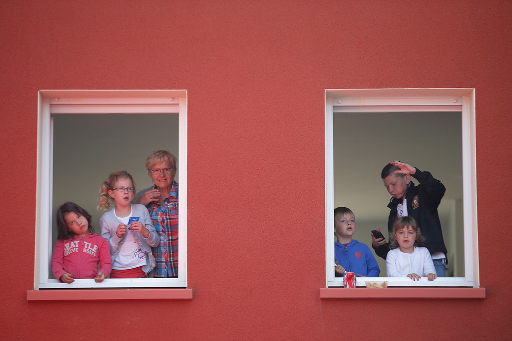 . Spectators watch the start of the twelfth stage of the Tour de France cycling race over 218 kilometers (136.2 miles) with start in in Fougeres and finish in Tours, western France, Thursday July 11 2013. (AP Photo/Christophe Ena)