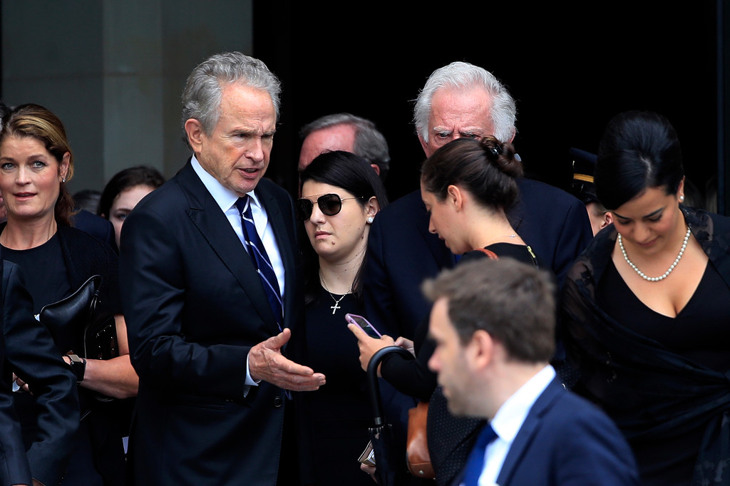 . Actor Warren Beatty greets guests following a memorial service for Sen. John McCain, R-Ariz., at the Washington National Cathedral in Washington, Saturday, Sept. 1, 2018. (AP Photo/Manuel Balce Ceneta)