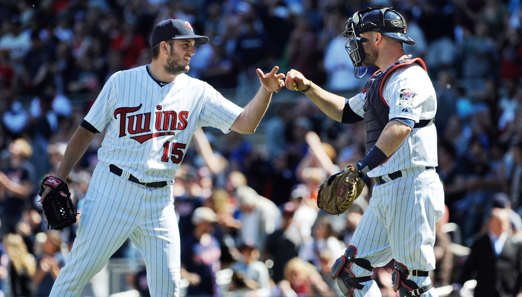 . Twins reliever Glen Perkins, left, celebrates with catcher Ryan Doumit after throwing a spotless ninth inning in Minnesota\'s 10-0 win over the Seattle Mariners at Target Field in Minneapolis on Sunday June 2, 2013. (AP Photo/Craig Lassig)