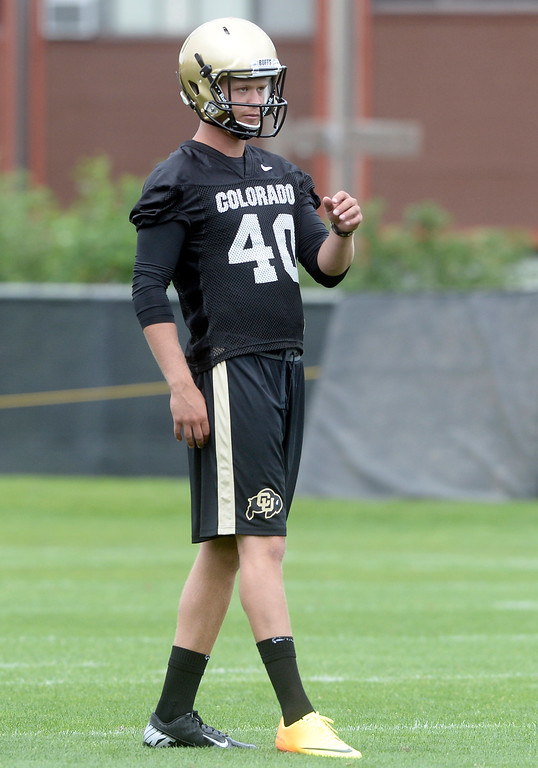 . University of Colorado placekicker Justin Castor waits to kick a field goal during the second fall football practice on Wednesday, Aug. 7, at the CU practice fields. For more photos of practice go to www.dailycamera.com Jeremy Papasso/Camera