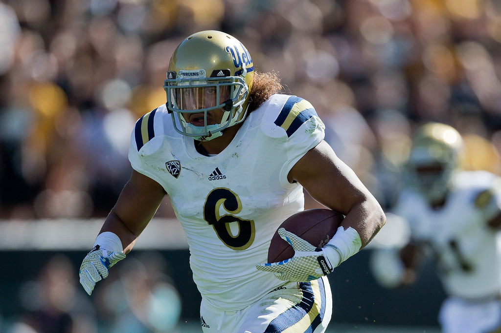 . BOULDER, CO - OCTOBER 25:  Linebacker Eric Kendricks #6 of the UCLA Bruins runs with the football after making an interception during the first quarter against the Colorado Buffaloes at Folsom Field on October 25, 2014 in Boulder, Colorado. (Photo by Justin Edmonds/Getty Images)