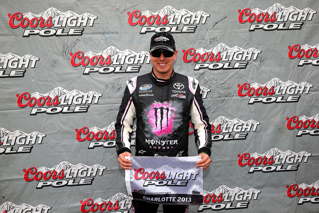 . CONCORD, NC - OCTOBER 11:  Kyle Busch, driver of the #54 Monster Energy Toyota, poses with the Coors Light Pole Award after qualifying for the pole for the NASCAR Nationwide Series Dollar General 300 at Charlotte Motor Speedway on October 11, 2013 in Concord, North Carolina.  (Photo by Streeter Lecka/Getty Images)