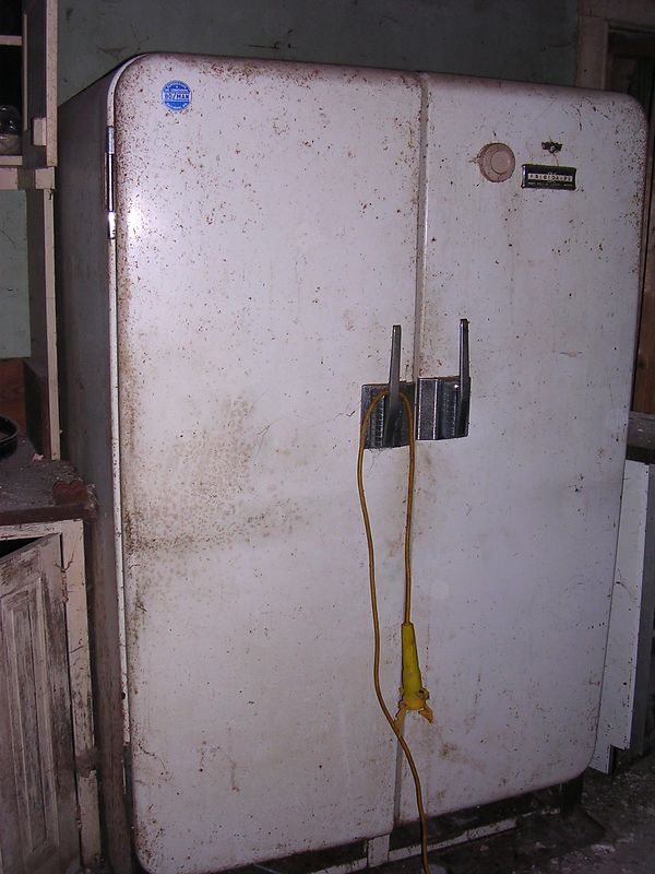 The old kitchen must have fed a lot of people. The old 1950s-era Frgidaire refrigerator next to the cabinet is commercial size.