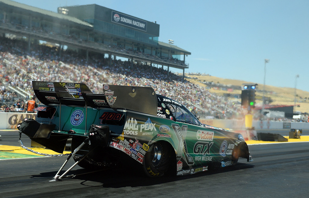 . Khalid alBalooshi (Top Fuel), Courtney Force (Funny Car), Jason Line (Pro Stock) and Eddie Krawiec (Pro Stock Motorcycle) all won event titles in their respective classes Sunday July 27, 2014 at the 27th annual NHRA Sonoma Nationals. (Will Lester/Staff Photographer)