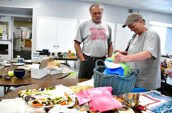 8/7/2019 Mike Orazzi | Staff Daphne and Bill Morris shop for items for sale during the Plainville Senior Center tag sale on Wednesday.