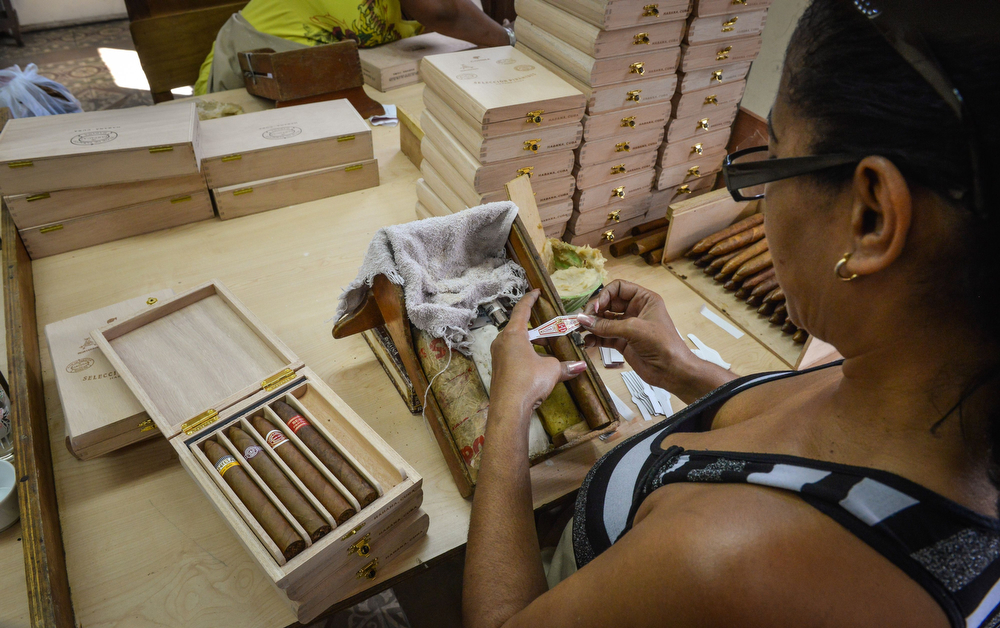 . An employee prepares boxes of cigars, on February 27, 2014 at the H. Upmann cigar factory in Havana. The production of Cuban cigars experienced an 8% growth in 2013 adding 447 million dollars to the Cuban economy. The XVI Havana Cigar Festival is running in Cuba with the presentation of the best Cuban cigars. (ALBERTO ROQUE/AFP/Getty Images)