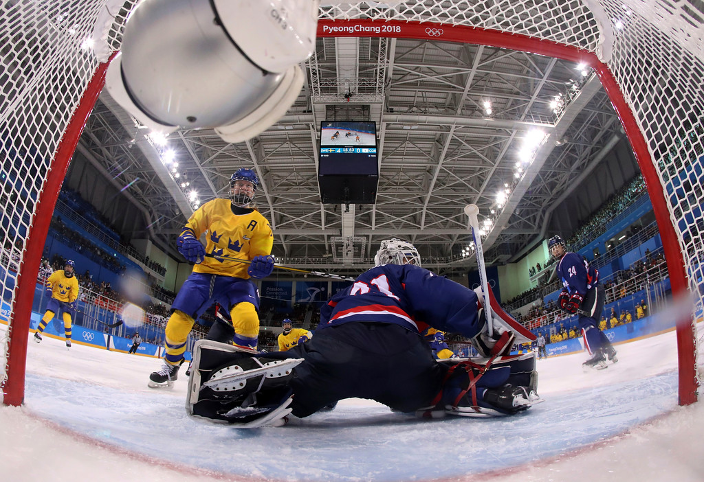 . Pernilla Winberg, left, of Sweden, reacts as she scores a goal against South Korea\'s goalie Shin So-jung, of the combined Koreas team, during the second period of the preliminary round of the women\'s hockey game at the 2018 Winter Olympics in Gangneung, South Korea, Monday, Feb. 12, 2018. (Bruce Bennett/Pool Photo via AP)