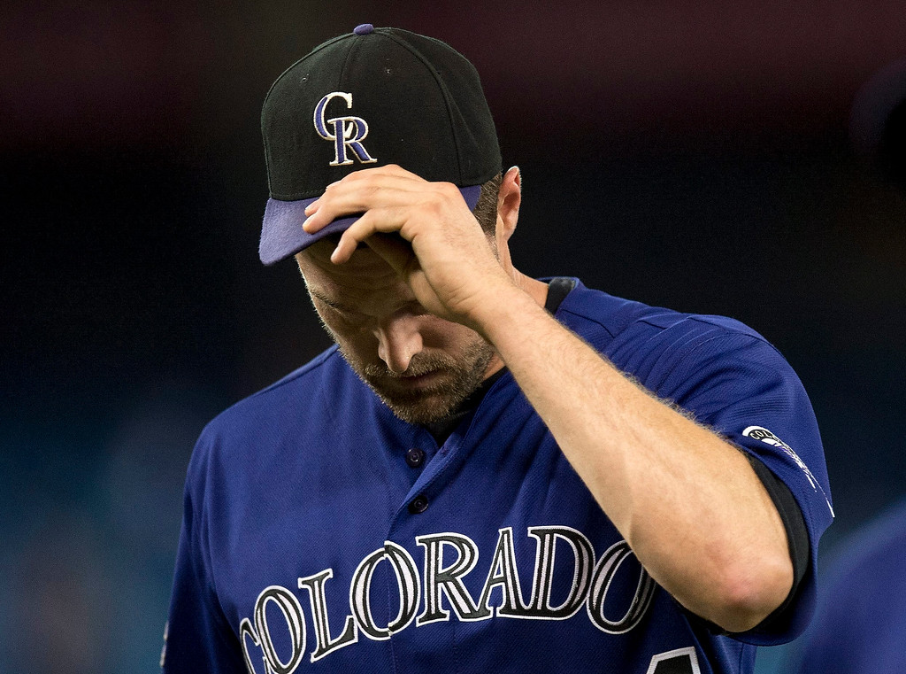 . Colorado Rockies pitcher Matt Belisle walks off the field after the eighth  inning during a baseball game against the Toronto Blue Jays in Toronto on Monday June 17, 2013.  (AP Photo/The Canadian Press, Frank Gunn)