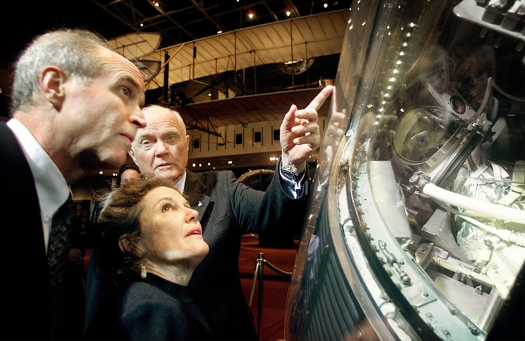 . FILE - In this Feb. 20, 2002, file photo, former U.S. Sen. John Glenn, D-Ohio, right, shows his son David Glenn, left, and daughter Lyn Glenn the Mercury spacecraft Friendship 7, in which he became the first American in orbit, during a ceremony marking the 40th anniversary of the first U.S. manned orbital flight at the Smithsonian Institution\'s National Air and Space Museum in Washington. Nate D. Sanders Auctions says in-flight instructions used by Glenn as he became the first American to orbit the Earth sold for $66,993 on Thursday, July 21, 2016, in Los Angeles. (AP Photo/Pablo Martinez Monsivais, File)