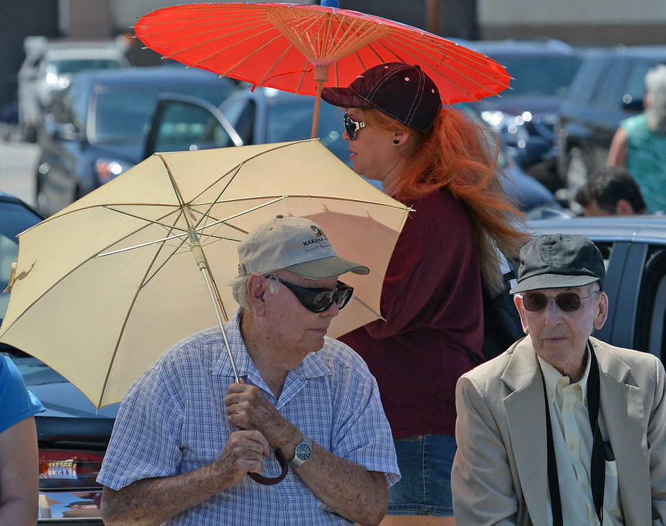 . Tall ships make their way up the Main Channel, past a large crowd at Warehouse 1, in the Port of Los Angeles for the Grand Parade of Sail Wednesday, August 20, 2014, San Pedro, CA.    People use umbrellas to hide from the sun while watching the parade. Photo by Steve McCrank/Daily Breeze