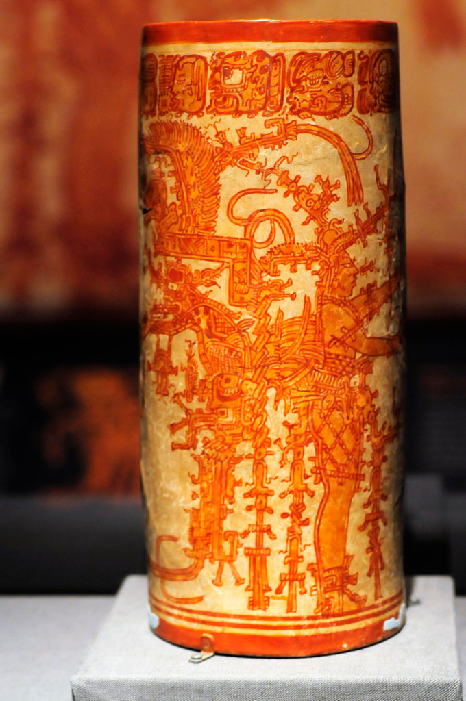 . Pottery Cylinder Vase, A.D. 700-800, from Buenavista del Cayo in Belize, depicts the Maize God\'s unending dance and  symbolizes both the creation of the universe and also his cycle of death and rebirth. (Pioneer Press: Scott Takushi)