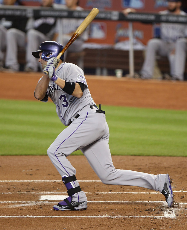 . Michael Cuddyer #3 of the Colorado Rockies drives in a run against the Miami Marlins during the first inning at Marlins Park on April 3, 2014 in Miami, Florida.  (Photo by Marc Serota/Getty Images)