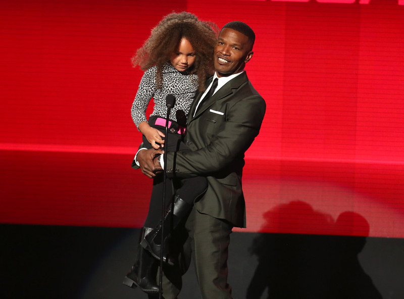 . Annalise Bishop, left, and Jamie Foxx present the award for favorite rap/hip-hop album at the 42nd annual American Music Awards at Nokia Theatre L.A. Live on Sunday, Nov. 23, 2014, in Los Angeles. (Photo by Matt SaylesInvision/AP)