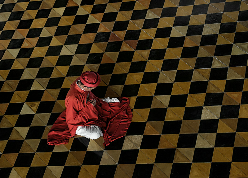 Worshipper deep in prayer at the Cao Dai great Temple.  Tay Ninh, North of Saigon, Vietnam, 2008