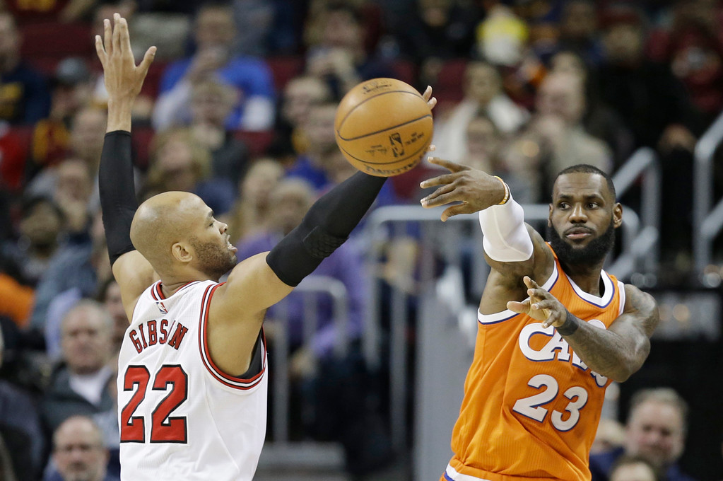 . Cleveland Cavaliers\' LeBron James (23) passes against Chicago Bulls\' Taj Gibson (22) in the second half of an NBA basketball game, Wednesday, Jan. 4, 2017, in Cleveland. The Bulls won 106-94. (AP Photo/Tony Dejak)