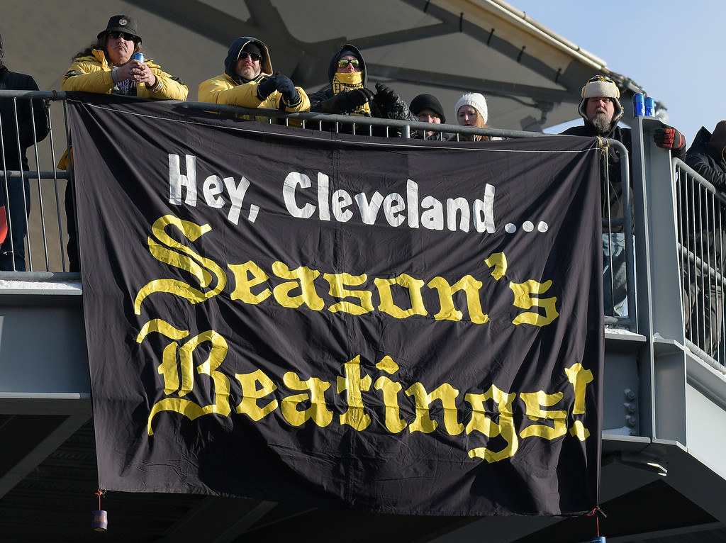 . Pittsburgh Steelers fans watch the second half of an NFL football game between the Pittsburgh Steelers and the Cleveland Browns in Pittsburgh, Sunday, Dec. 31, 2017. (AP Photo/Don Wright)