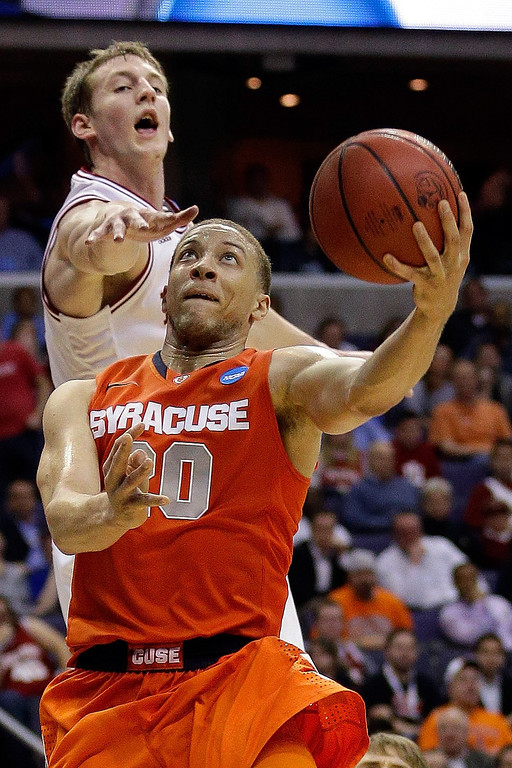 . Brandon Triche #20 of the Syracuse Orange goes to the hoop against Cody Zeller #40 of the Indiana Hoosiers during the East Regional Round of the 2013 NCAA Men\'s Basketball Tournament at Verizon Center on March 28, 2013 in Washington, DC.  (Photo by Rob Carr/Getty Images)
