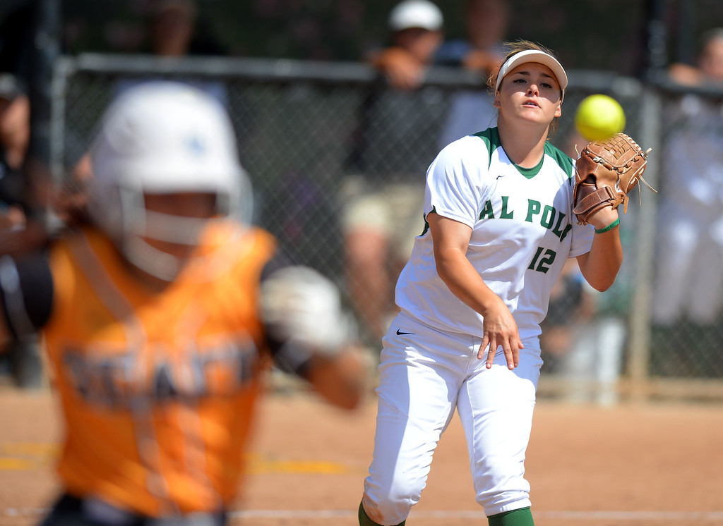 . Cal Poly pitcher Sierra Hyland throws out LBSU\'s Leilani Tupua-Tautalatasi as LBSU lost to Cal Poly softball 3-0 in Long Beach, CA on Sunday, May 4, 2014.  (Photo by Scott Varley, Daily Breeze)