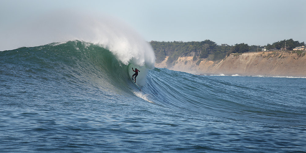 . Peter Mel is framed and silhouetted by the falling wave lip during a steep drop in his semifinal heat.  Mel, who grew up in Santa Cruz, won the Mavericks Invitational Sunday in Half Moon Bay.  (Dan Coyro/Sentinel)