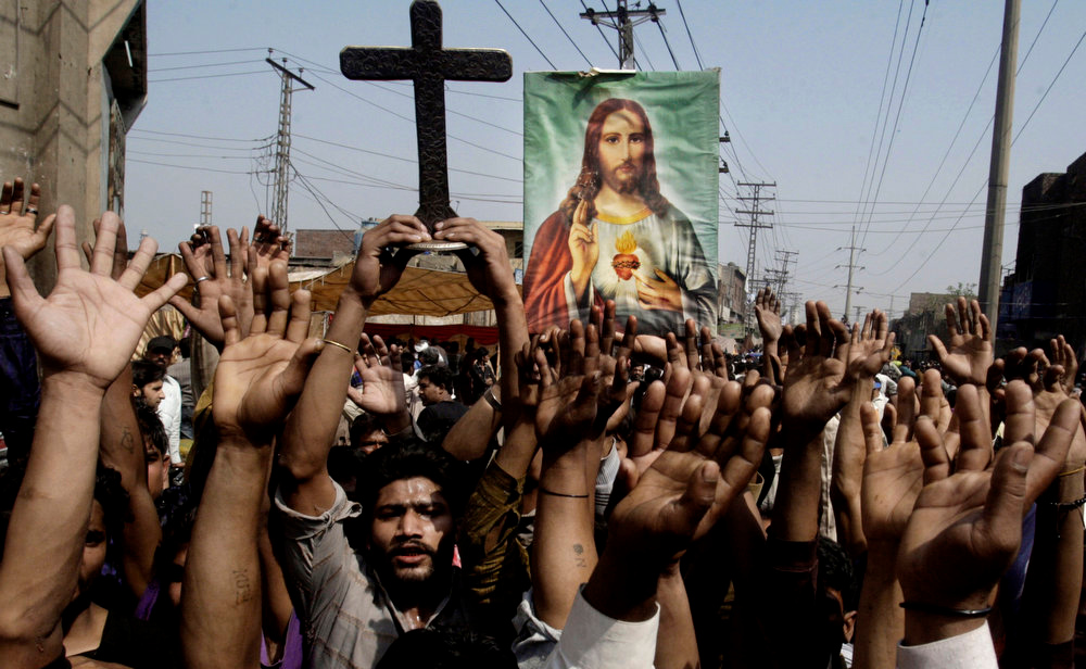 . Pakistani Christians raise their hands during a demonstration in Lahore, Pakistan, Sunday, March 10, 2013. Hundreds of Christians protesting the burning of their homes by a Muslim mob over alleged blasphemous remarks made against the Islam\'s Prophet Muhammad clashed with police on Sunday in eastern and southern Pakistan. (AP Photo/K.M. Chaudary)