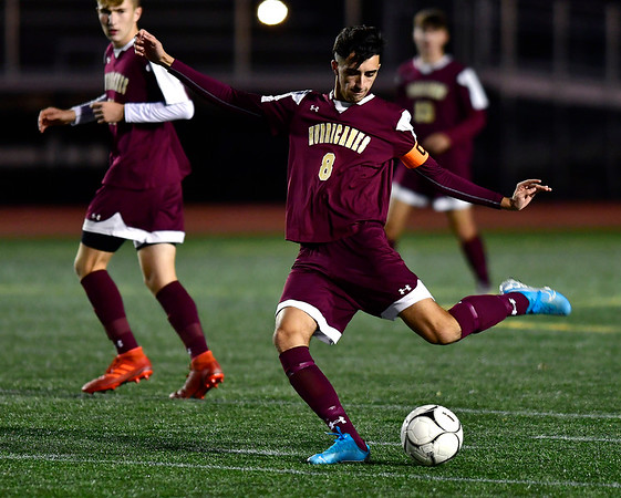 10/24/2019 Mike Orazzi | StaffrNew Britain's John Morell (8) during Thursday night's boys soccer with Simsbury at Veterans Stadium in New Britain.
