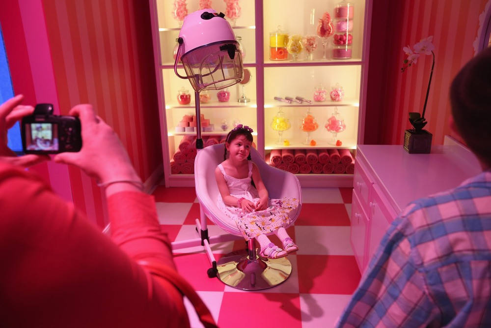 . Tanja, 6, is photographed by her father while visiting Barbie\'s bathroom at the Barbie Dreamhouse Experience on May 16, 2013 in Berlin, Germany. The Barbie Dreamhouse is a life-sized house full of Barbie fashion, furniture and accessories and will be open to the public until August 25 before it moves on to other cities in Europe.  (Photo by Sean Gallup/Getty Images)
