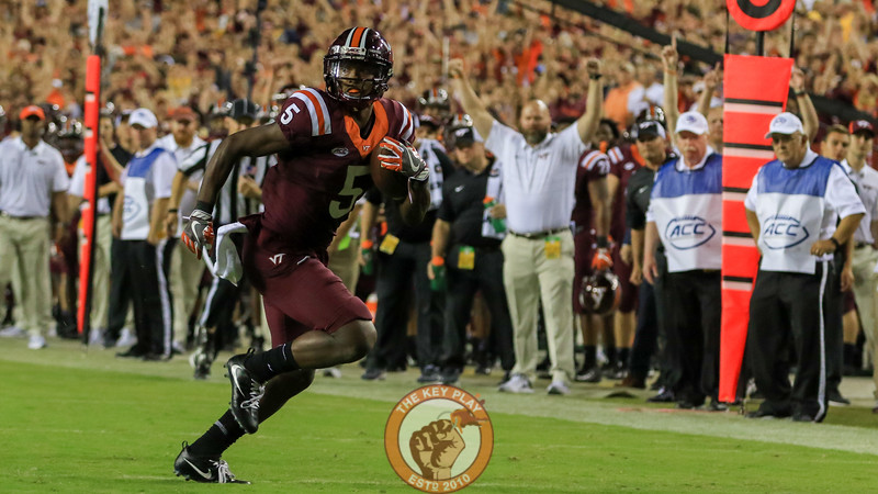 WR Cam Phillips runs to the endzone as the Virginia Tech sideline starts to celebrate. (Mark Umansky/TheKeyPlay.com)