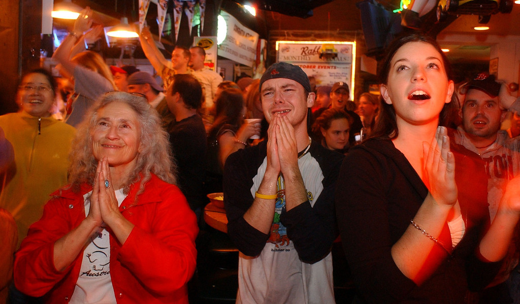 . Boston Red Sox fans at Rafter\'s Bar in Amherst, Mass., react to the Red Sox\'s 3-0 victory over the St. Louis Cardinals in Game 4 of the   World Series on Wednesday, Oct. 27, 2004. The Red Sox won the World Series for the first time since 1918. (AP Photo/Nathan Martin)