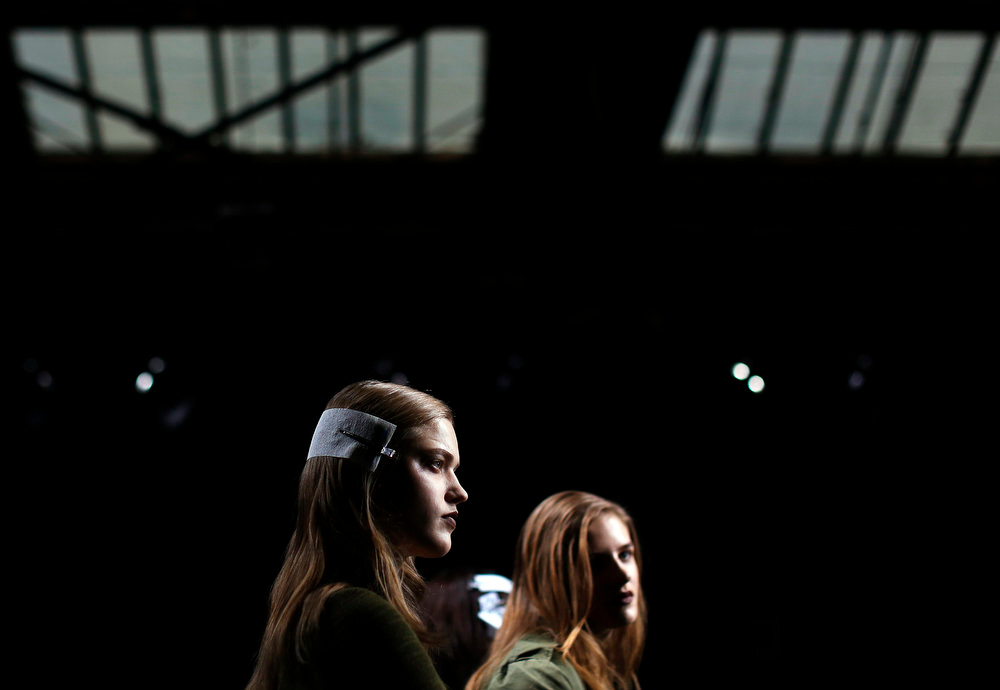 Description of . Models stand on the runway before the start of the 3.1 Phillip Lim Autumn/Winter 2013 collection during New York Fashion Week, February 11, 2013., REUTERS/Shannon Stapleton
