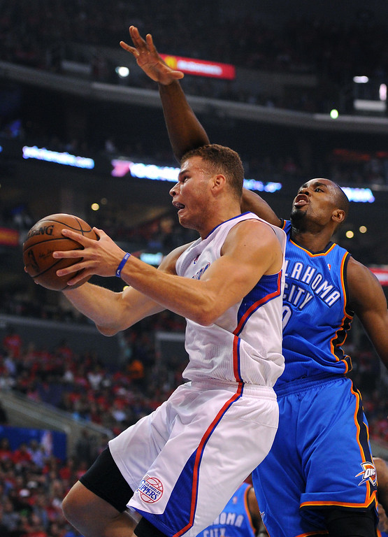 . The Clippers\' Blake Griffin goes to the basket against the Thunder\'s Serge Ibaka, Friday, May 9, 2014, at Staples Center. (Photo by Michael Owen Baker/Los Angeles Daily News)